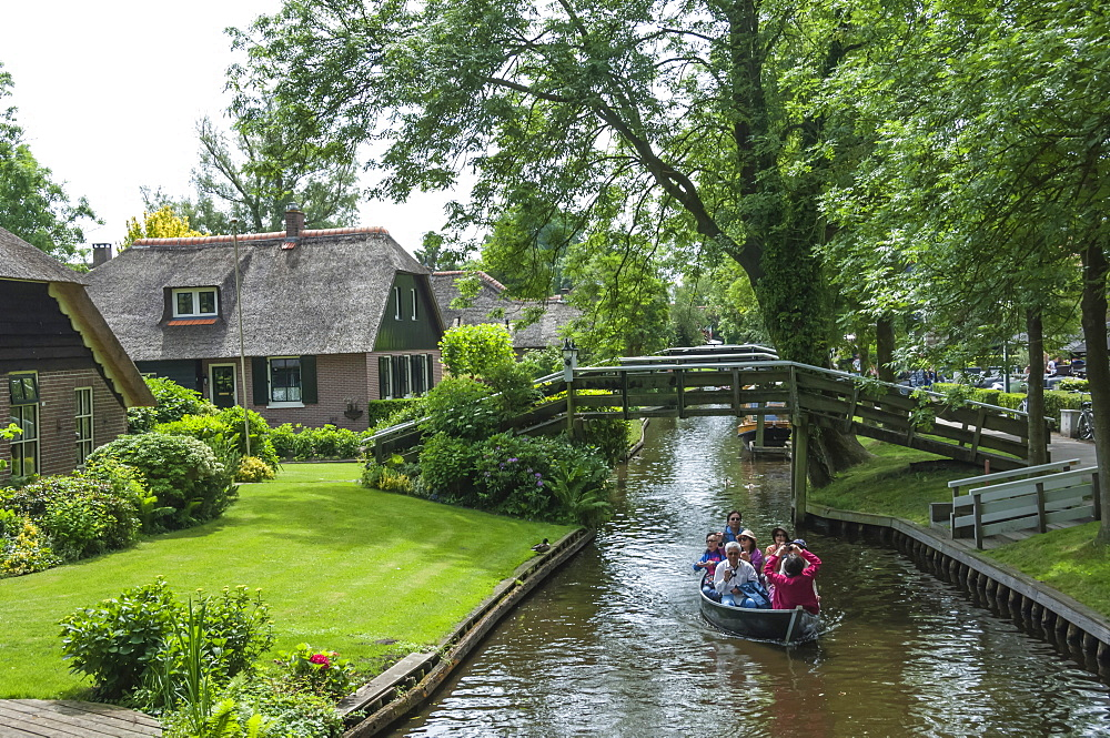 Tourists on the canal at Giethorn, Holland, Europe