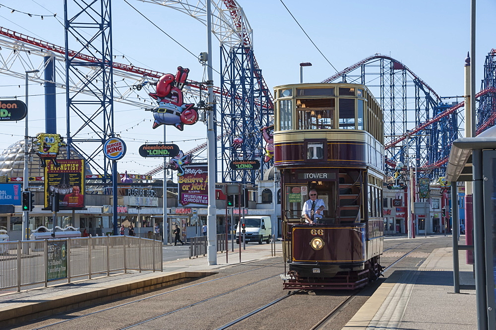 Traditional tram passing the Pleasure Beach, Blackpool, Lancashire, England, United Kingdom, Europe - 747-1872