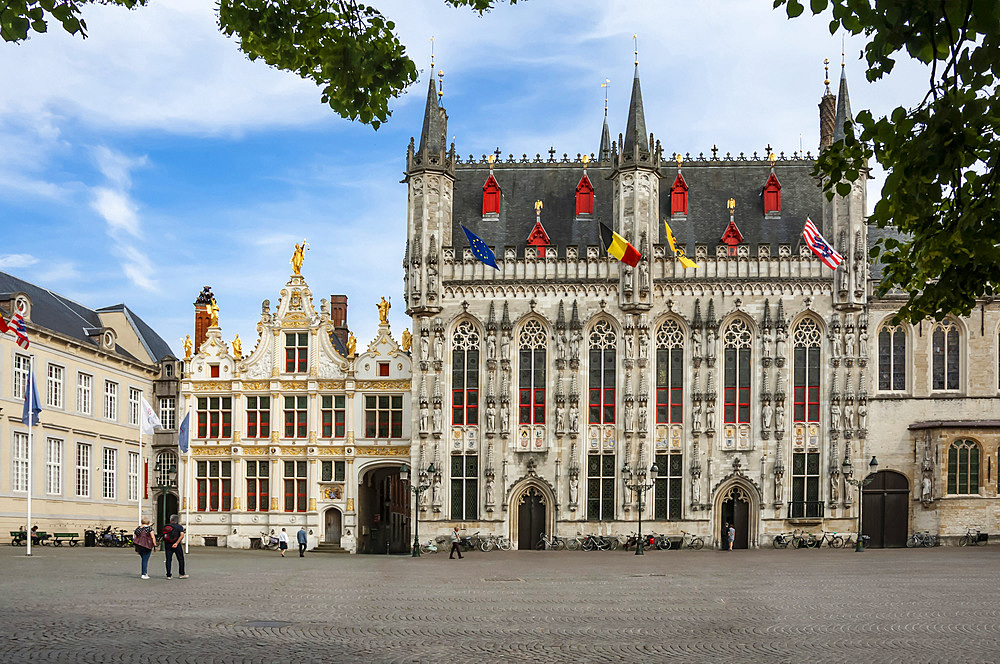 The 14th century Stadhuis (City Hall), National Flags, Burg Square, Brugge, UNESCO World Heritage Site, West Flanders, Belgium, Europe