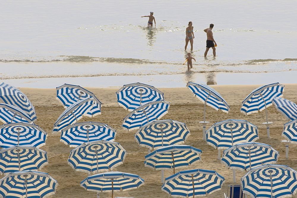 Umbrellas on the beach, family in the sea, Jesolo, Venetian Lagoon, Veneto, Italy, Europe