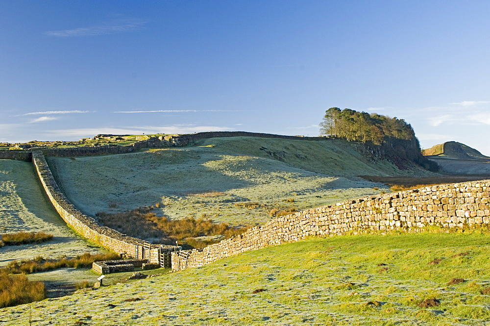 Hadrians Wall with civilian gate, a unique feature, and Housesteads Fort, Northumbria, England, United Kingdom, Europe