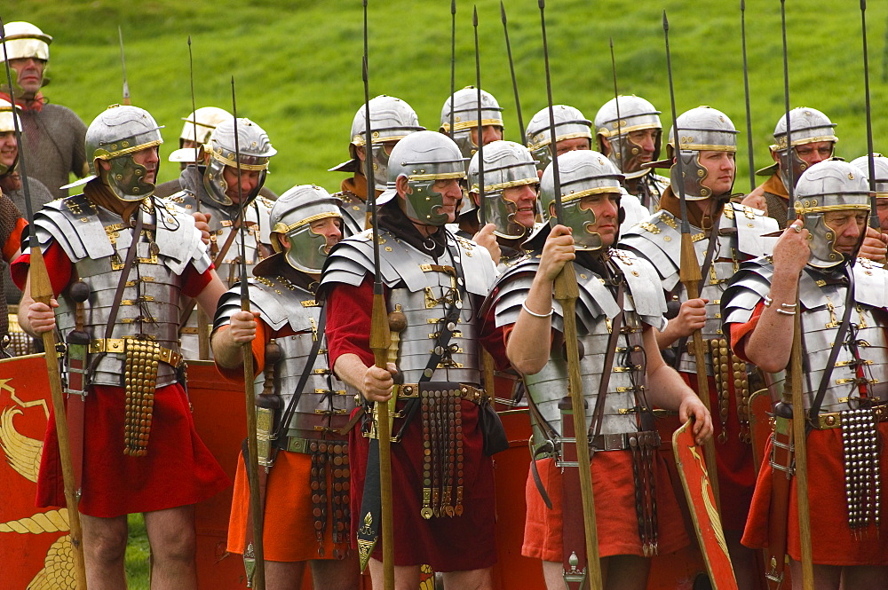 Ermine Street Guard in armour, at ease, Birdoswald Roman Fort, Hadrians Wall, Northumbria, England, United Kingdom, Euruope