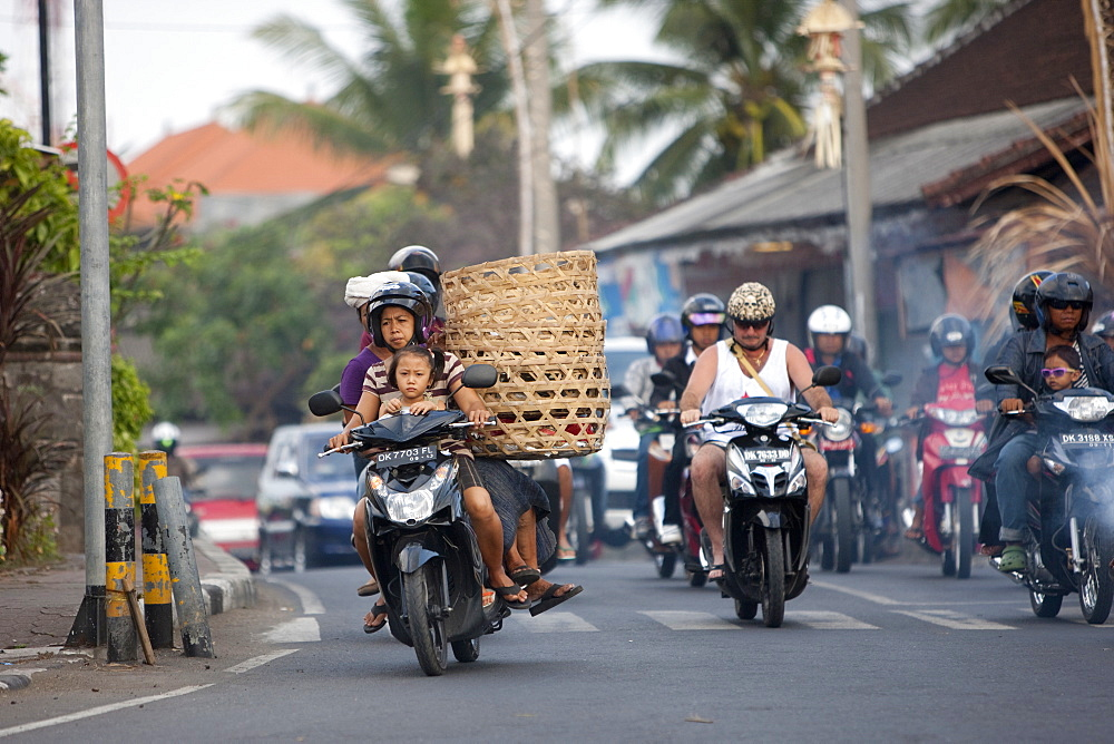 Motor cycles in traffic, Kuta, Bali, Indonesia, Southeast Asia, Asia