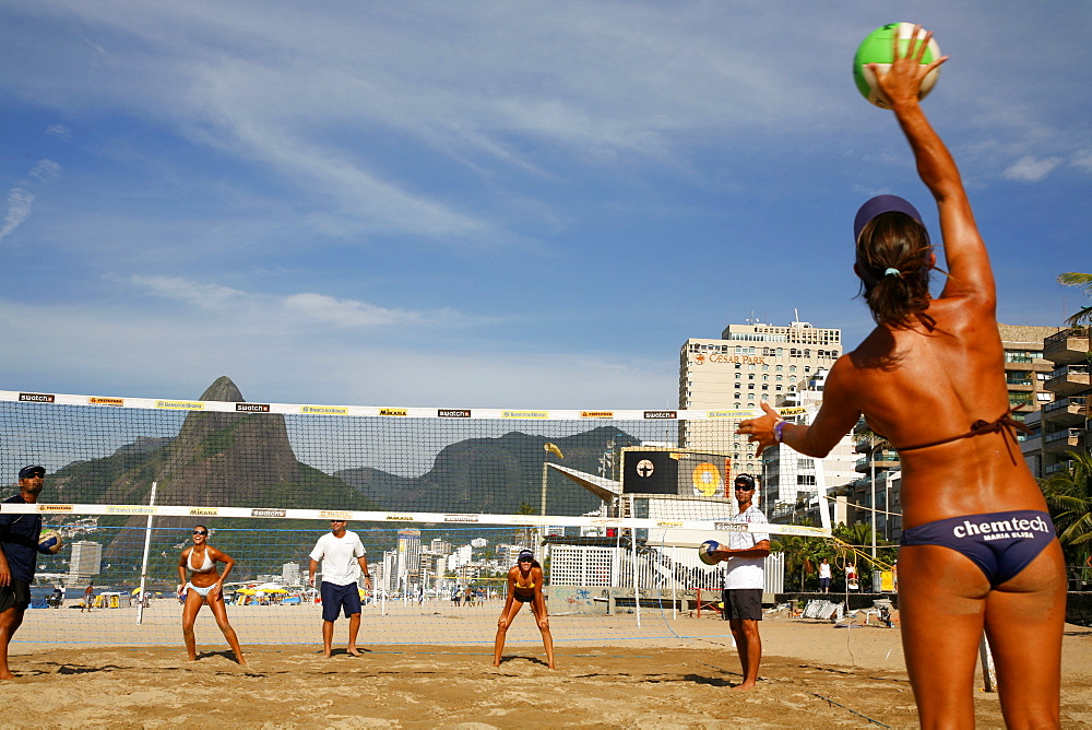 Women playing volleyball on Ipanema beach, Rio de Janeiro, Brazil, South America
