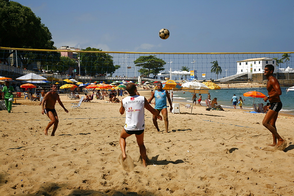 Men playing foot volleyball at Porto da Barra beach, Salvador (Salvador de Bahia), Bahia, Brazil, South America