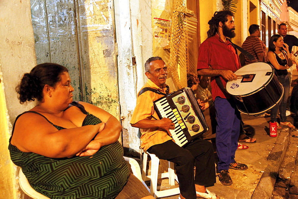 People playing music on the street at night in Olinda, Pernambuco, Brazil, South America