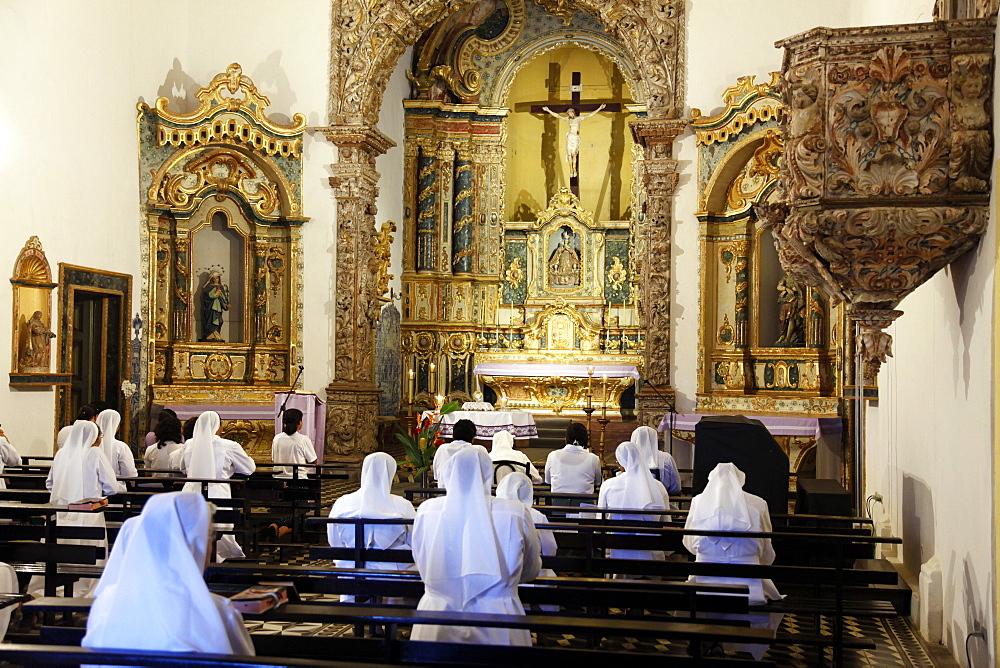 Nuns praying at the Misericordia church, Olinda, Pernambuco, Brazil, South America
