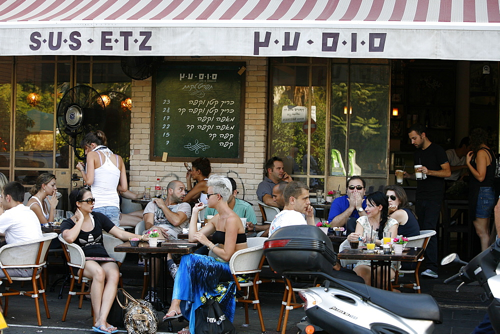 Young people sitting at Sus Etz Cafe in the trendy Sheinkin street, Tel Aviv, Israel, Middle East