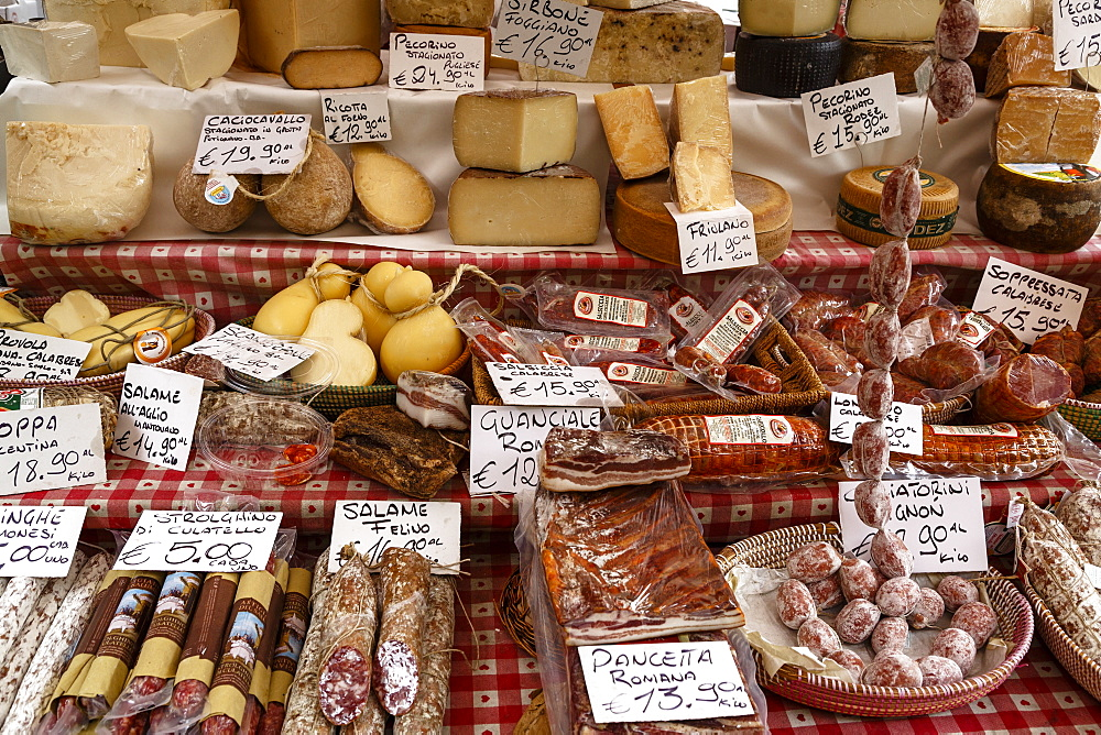 Cheese and salamis at Papiniano market, Milan, Lombardy, Italy, Europe