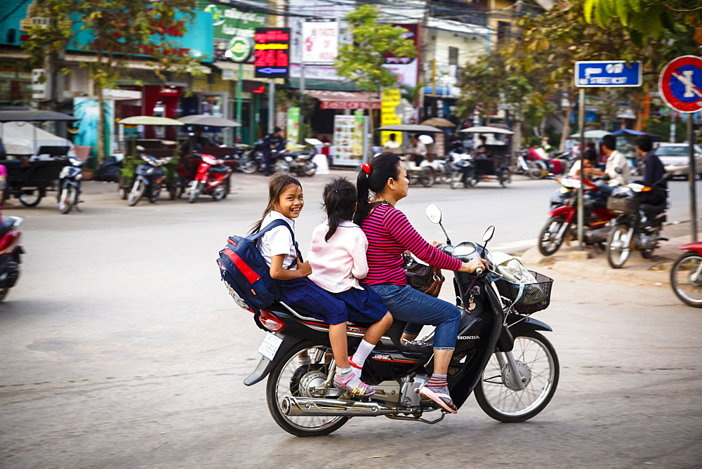 Mother and daughters riding a scooter, Siem Reap, Cambodia, Indochina, Southeast Asia, Asia