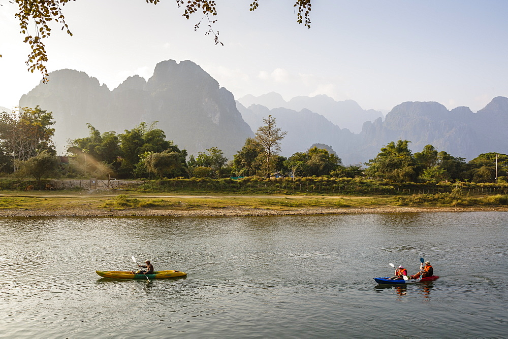 People kayaking on the Nam Song River, Vang Vieng, Laos, Indochina, Southeast Asia, Asia