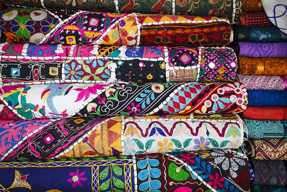 Colourful hand woven fabrics at Mapusa Market, Goa, India, Asia
