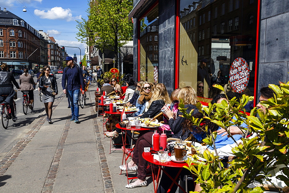People sitting at the laundromat cafe on Gammel Kongevej, Frederiksberg, Copenhagen, Denmark, Scandinavia, Europe