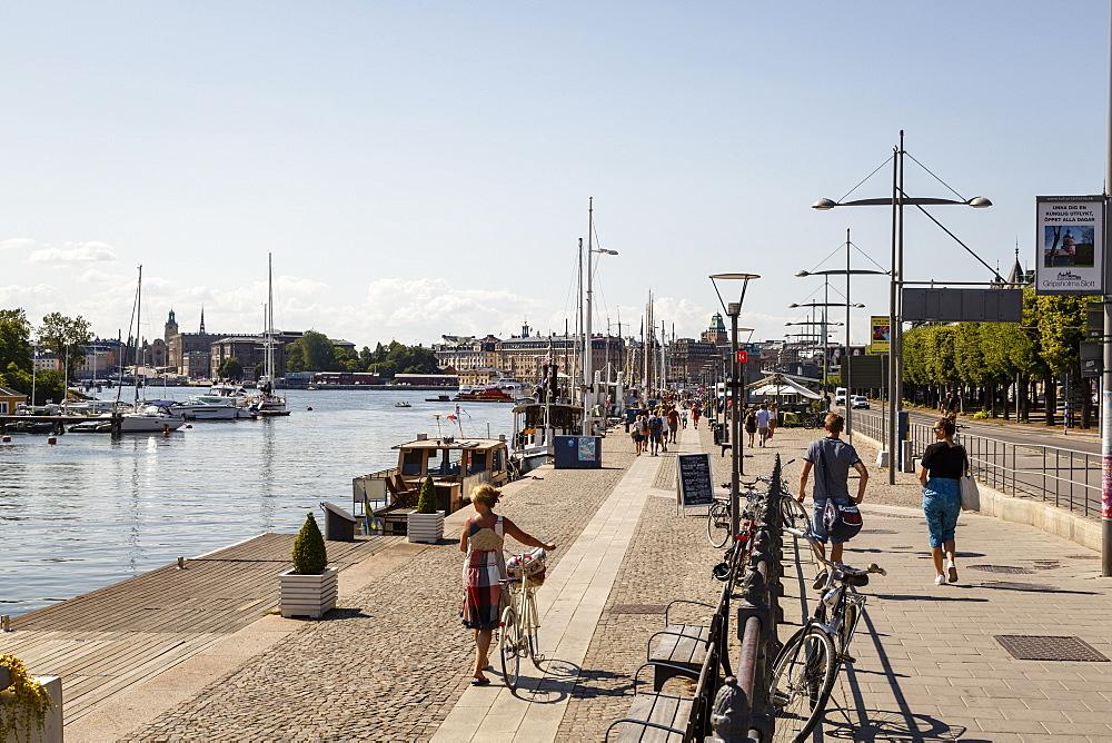 People walking along Strandvagen street, Stockholm, Sweden, Scandinavia, Europe