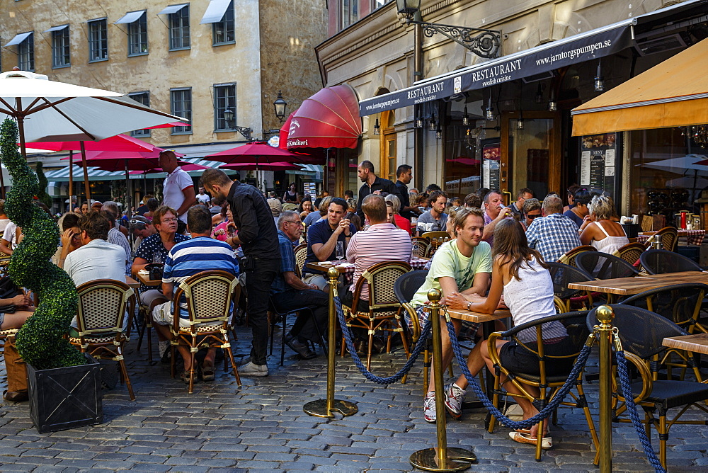People sitting at a restaurant in Jarntorget square in Gamla Stan, Stockholm, Sweden, Scandinavia, Europe