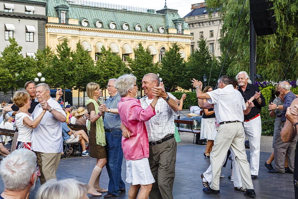 People dancing at Kungstradgarden (King's Garden) park, Stockholm, Sweden, Scandinavia, Europe