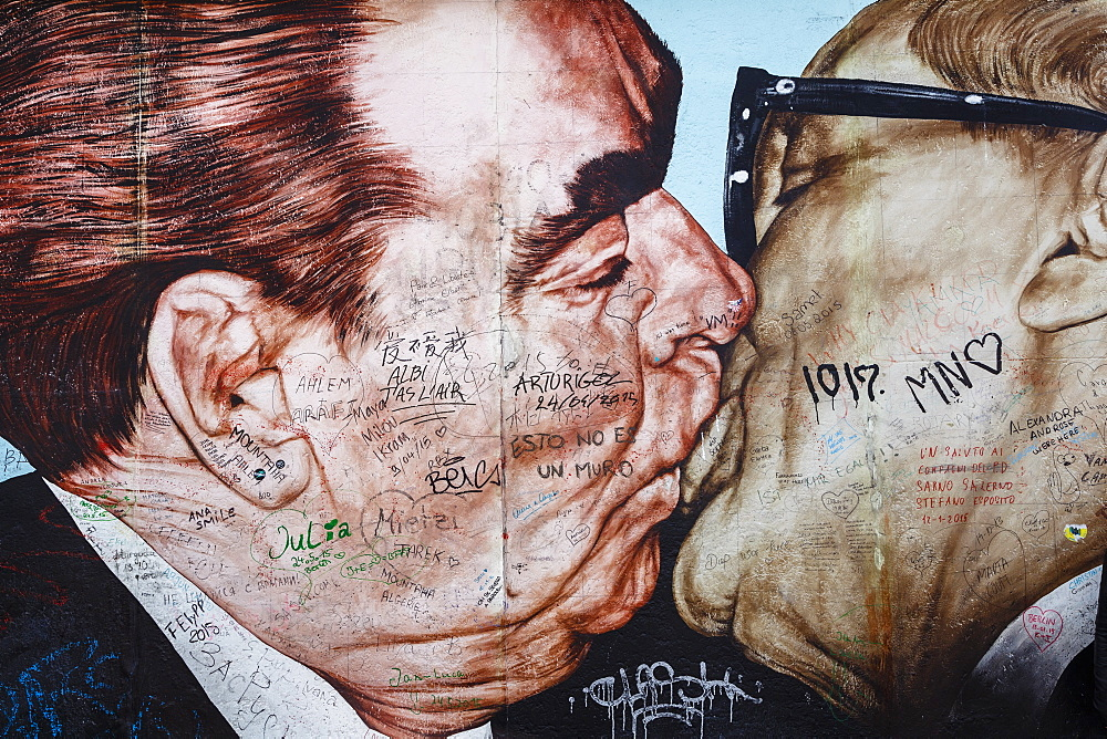 Painting by Russian artist Dimitry Vrubel of Brezhnev kissing Honecker at the remaining section of the Berlin Wall at the East Side Gallery, Friedrichshain, Berlin, Germany, Europe - 749-2267