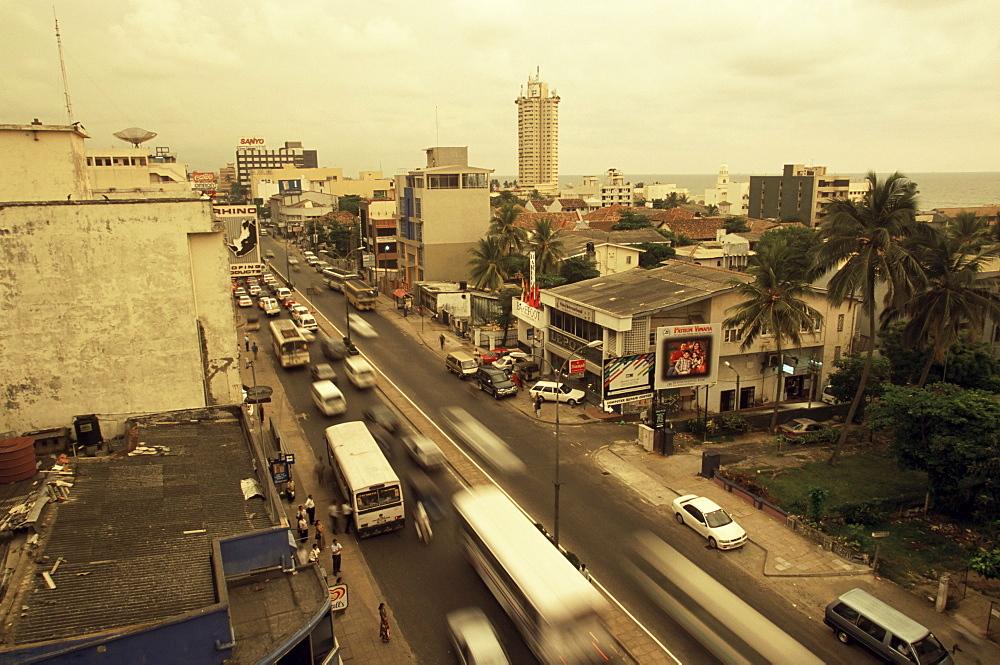 Traffic in Colombo beneath monsoon skies, Sri Lanka, Asia