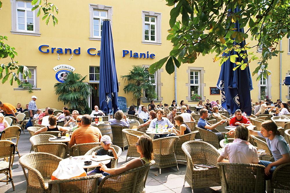 People sitting at an outdoor cafe on Karlsplatz, Stuttgart, Baden Wurttemberg, Germany, Europe