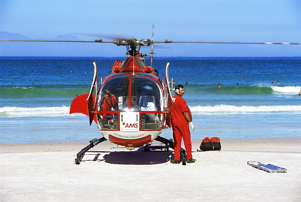 First aid medical helicopter lands on the beach, South Africa, Africa