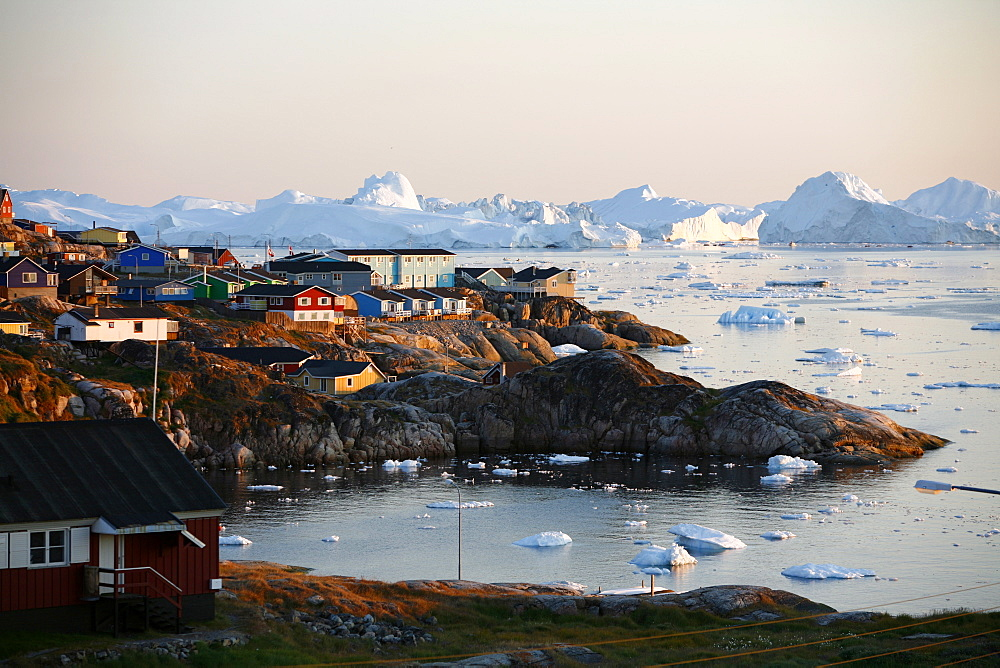 A view over houses and the Ilulissat Kangerlua Glacier also known as Sermeq Kujalleq, Ilulissat, Disko Bay, Greenland, Polar Regions