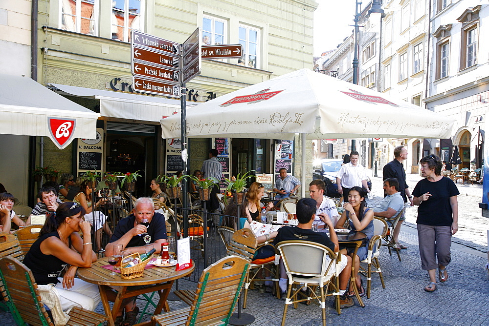 People sitting at an outdoor cafe in Malostranske Namesti Square, Mala Strana, Prague, Czech Republic, Europe