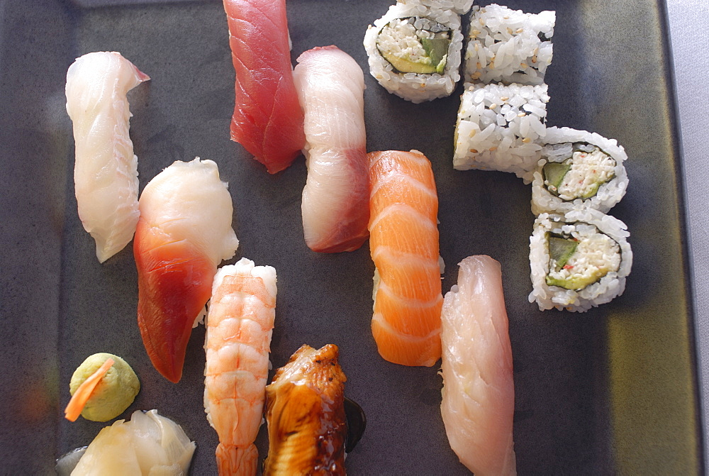 Plate of sushi covered with raw fish and stuffed, Japan, Asia