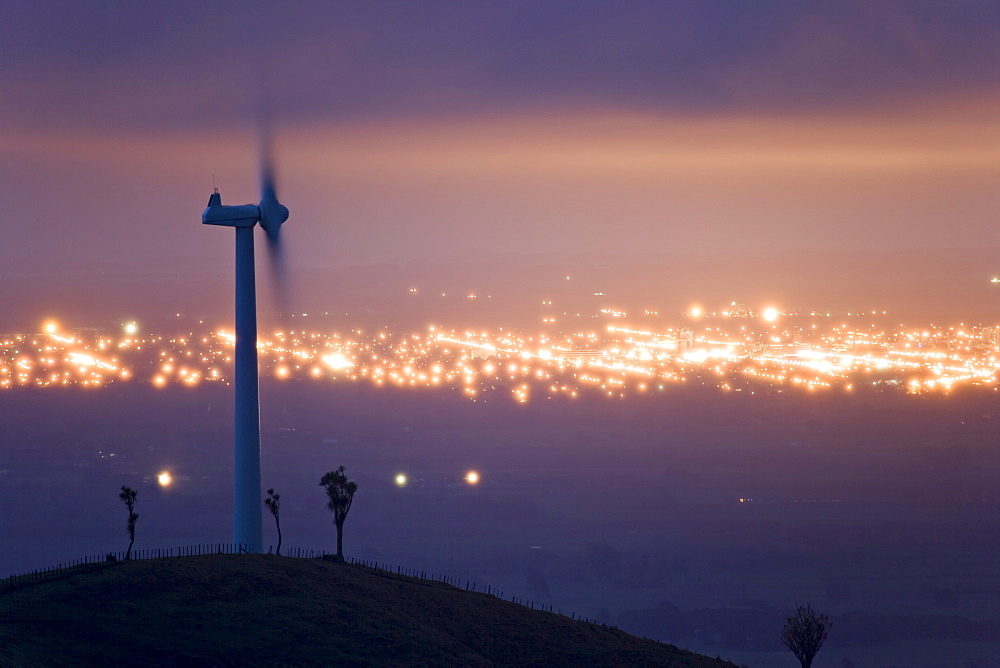 Te Apiti Wind Farm at dawn, on the lower Ruahine Ranges, with the lights of Palmerston North beyond, Manawatu, North Island, New Zealand, Pacific