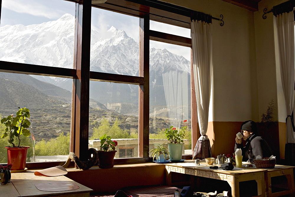 View of the Nilgiri range whilst enjoying breakfast in Om's Home hotel at Jomsom on the Annapurna circuit trek, Himalayas, Nepal, Asia