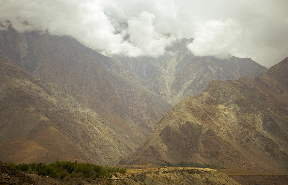 Dramatic summer monsoon clouds over the Karakoram ranges, Karakoram Highway, Northern areas, Pakistan, Asia