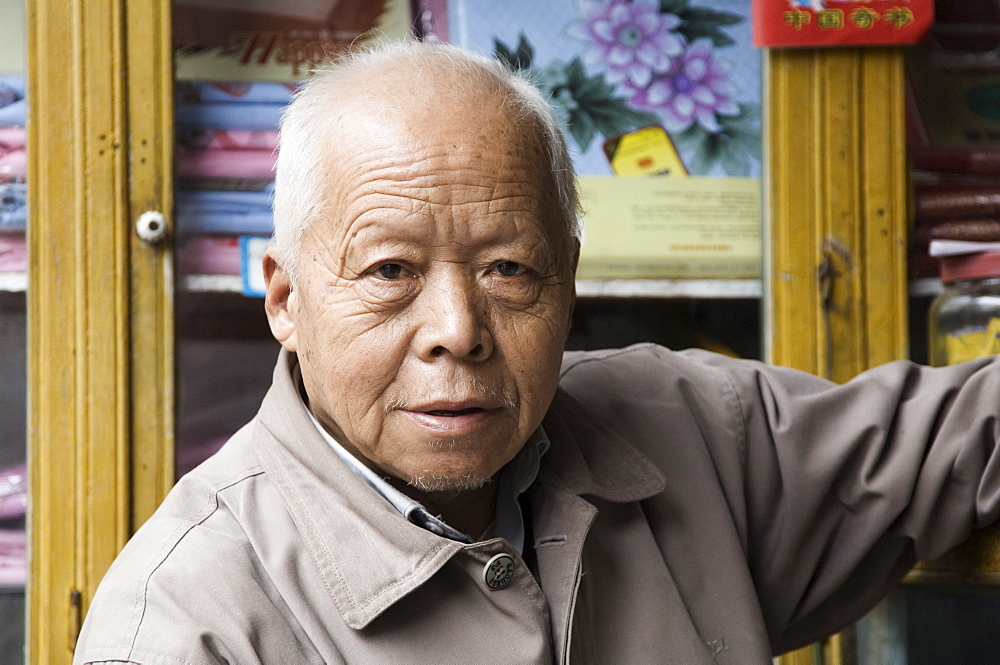Portrait of Chinese shop owner, Huangshan City (Tunxi), Anhui Province, China, Asia