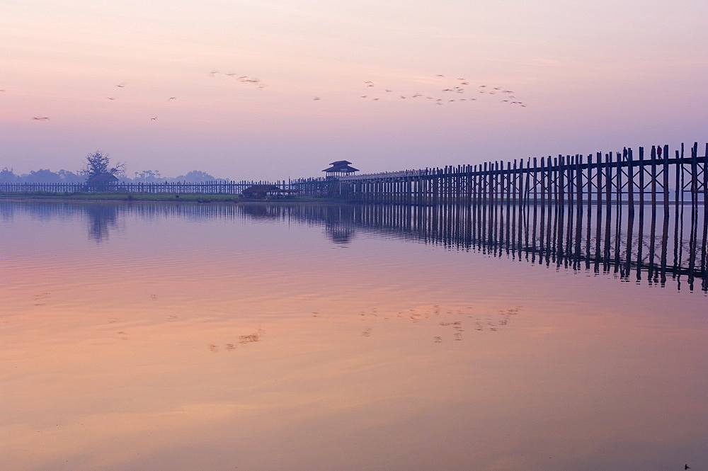 U Bein's Bridge across Thaungthaman Lake, at 1.2 km long the world's longest teak bridge, Amarapura, Myanmar (Burma), Asia