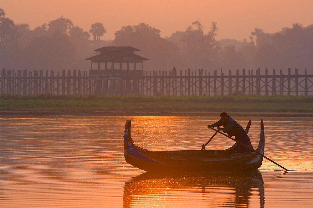 Boat on Thaungthaman Lake, and U Bein's Bridge, at 1.2 km long the world's longest teak bridge, Amarapura, Myanmar (Burma), Asia - 756-772