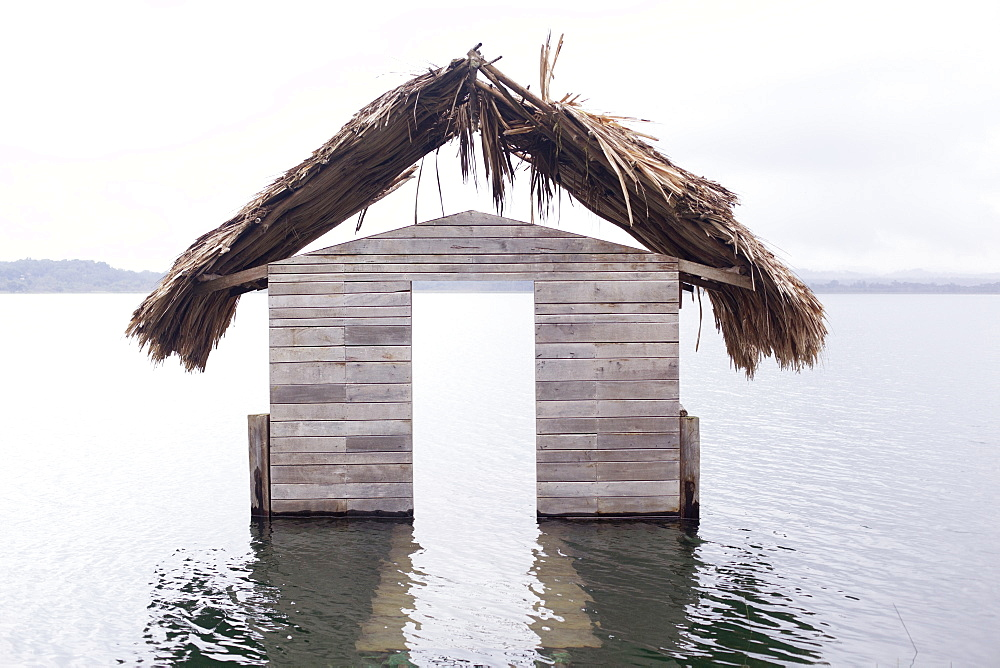 High water floods lakeside cabanas, Climate Change, Lago Peten Itza, Guatemala, Central America