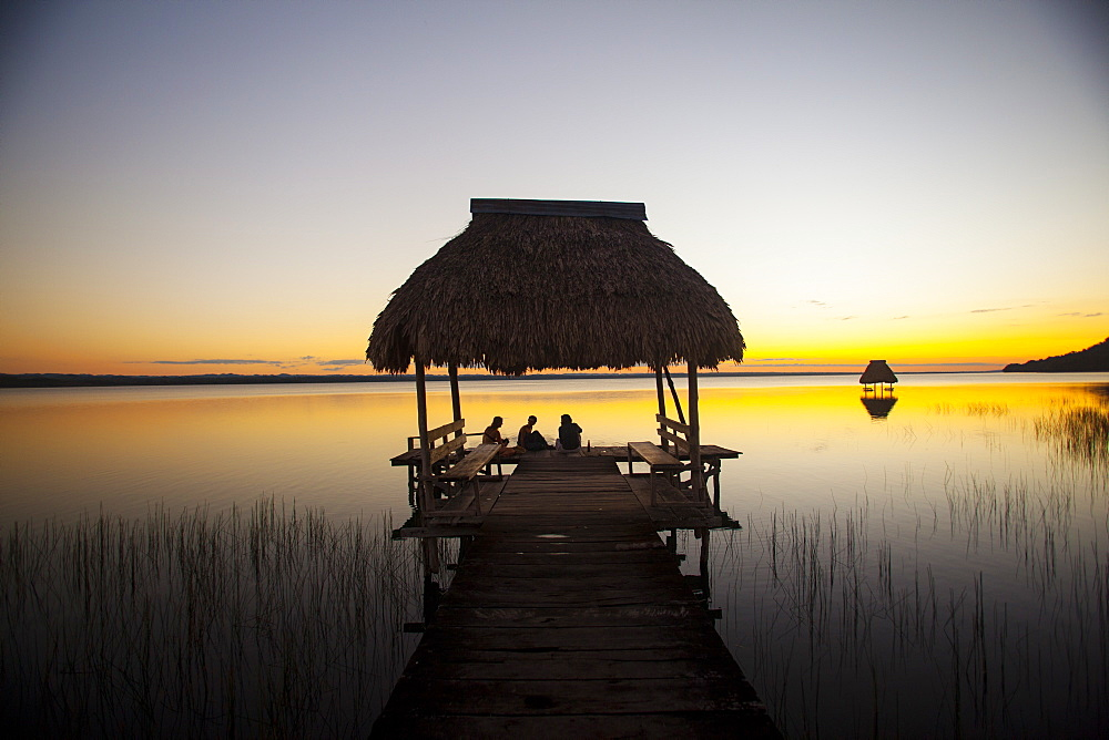People relaxing at sunset, Lago Peten Itza, El Remate, Guatemala, Central America - 757-239