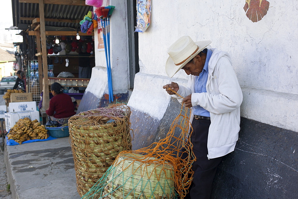 Man mending basket, Nebaj, Guatemala, Central America