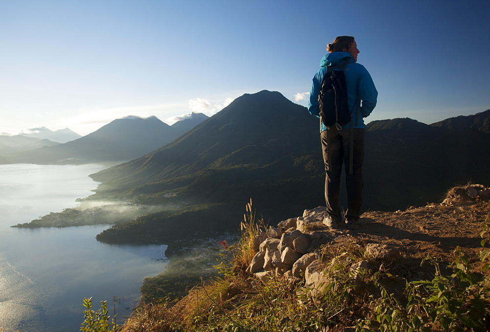 Woman enjoying the view from the Indian Nose lookout, Lago Atitlan, Guatemala, Central America