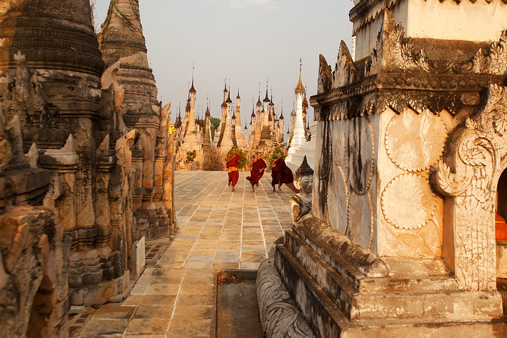 Young novices run through the pagodas, Kakku Pagoda Complex, Myanmar (Burma), Asia