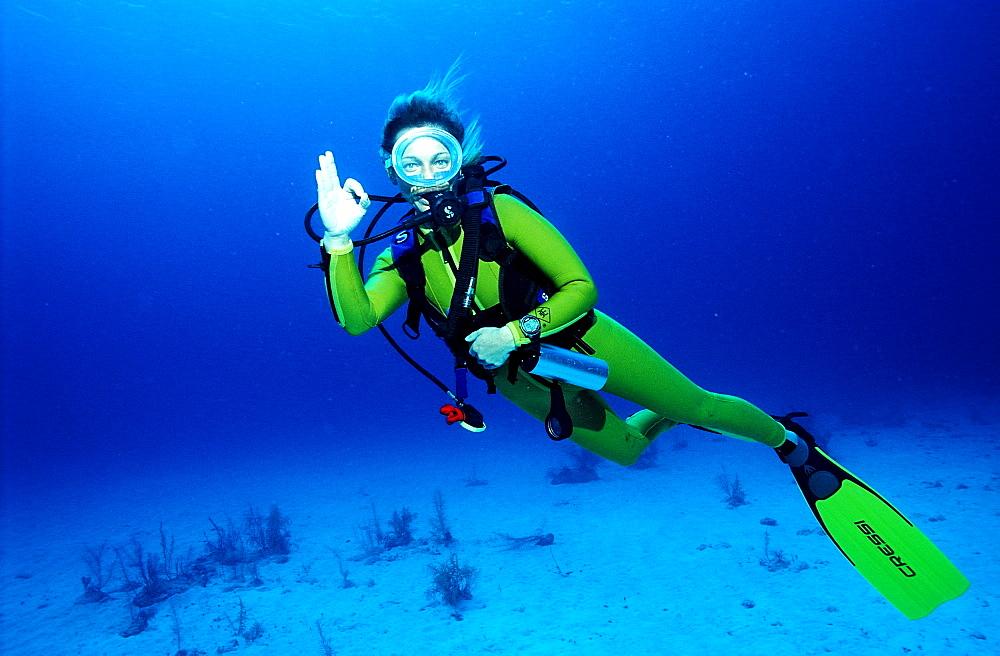 Scuba diver shows o.K. signal, Bahamas, Caribbean Sea, Grand Bahama Island