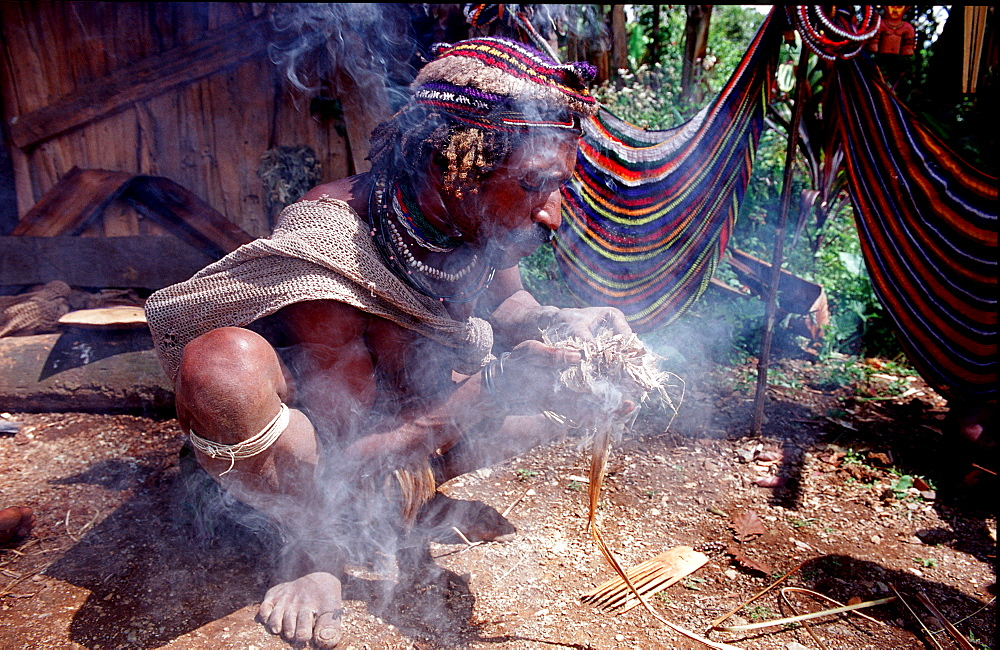Huli makes fire, Papua New Guinea, Tari, Huli, Highlands