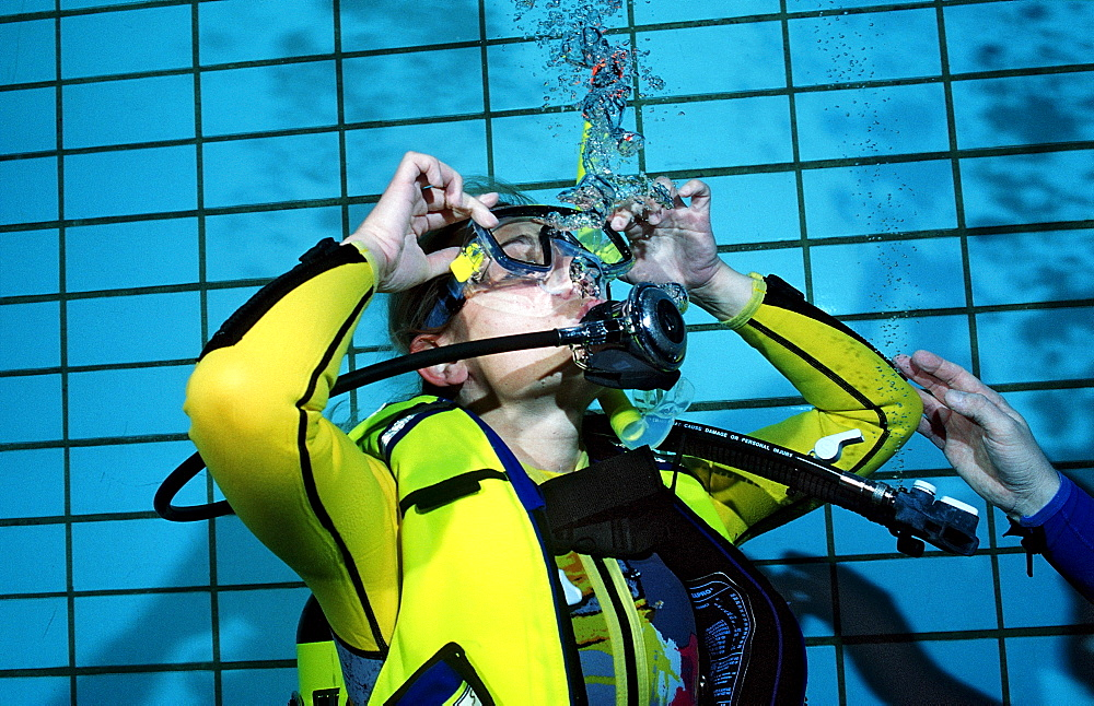 scuba diving lessons in a swimming pool, blow out diving mask, Germany, Munich, Olympiabad