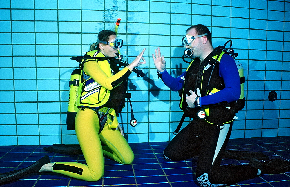 scuba diving lessons in a swimming pool, giving OK signal, Germany, Munich, Olympiabad
