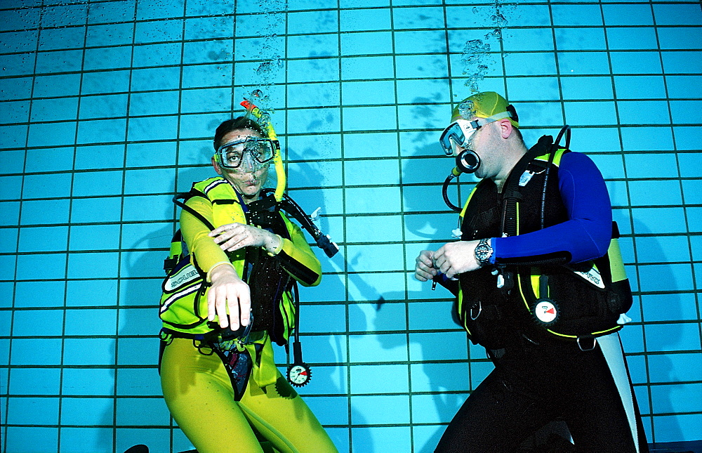scuba diving lessons in a swimming pool, reaching regulator, Germany, Munich, Olympiabad