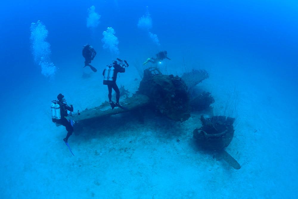 Diver and Bomber near to USS Saratoga, Marshall Islands, Bikini Atoll, Micronesia, Pacific Ocean