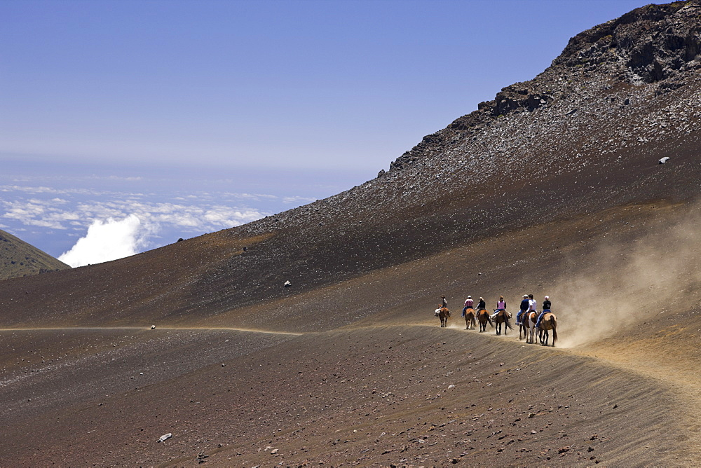 Horse Riding at Crater of Haleakala Volcano, Maui, Hawaii, USA