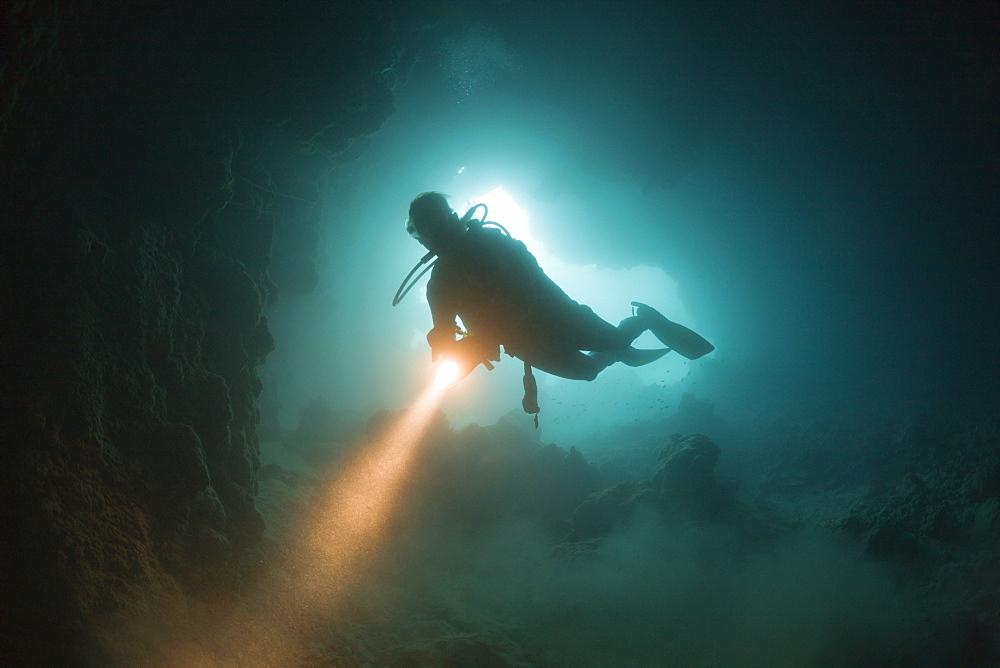 Diver at Entrance of Chandelier Dripstone Cave, Micronesia, Palau