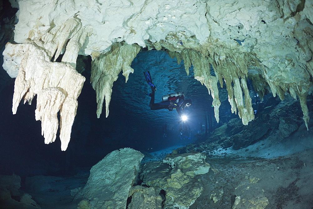 Scuba diver at Dos Ojos Cenote, Playa del Carmen, Yucatan Peninsula, Mexico