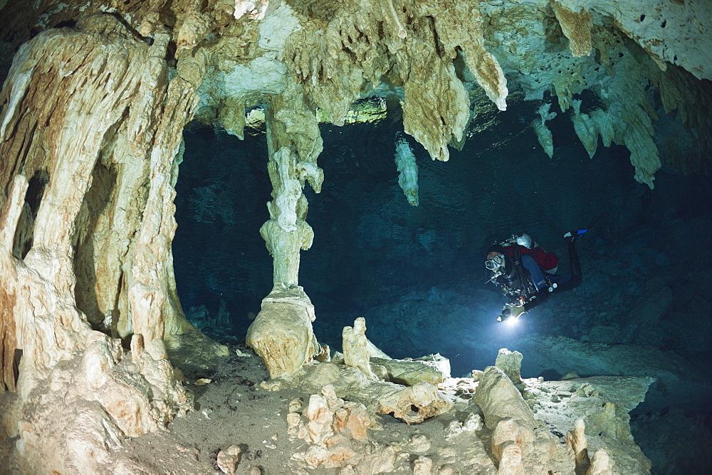 Scuba Diver in Dos Ojos Cenote, Playa del Carmen, Yucatan Peninsula, Mexico