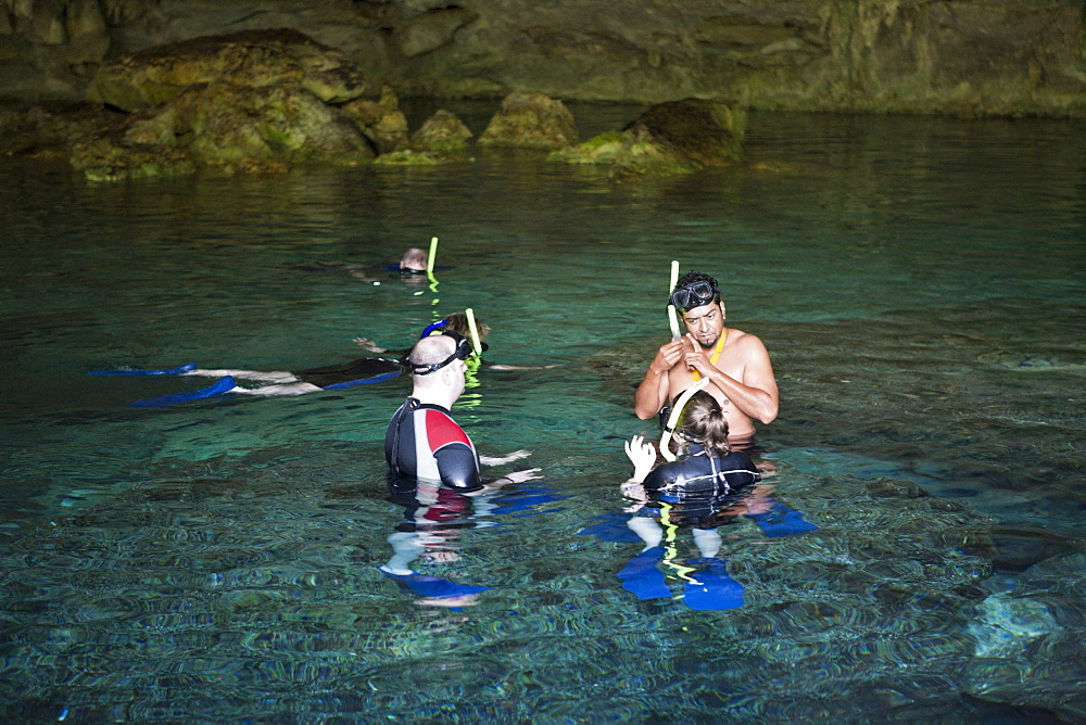 Tourists at Dos Ojos Cenote, Playa del Carmen, Yucatan Peninsula, Mexico