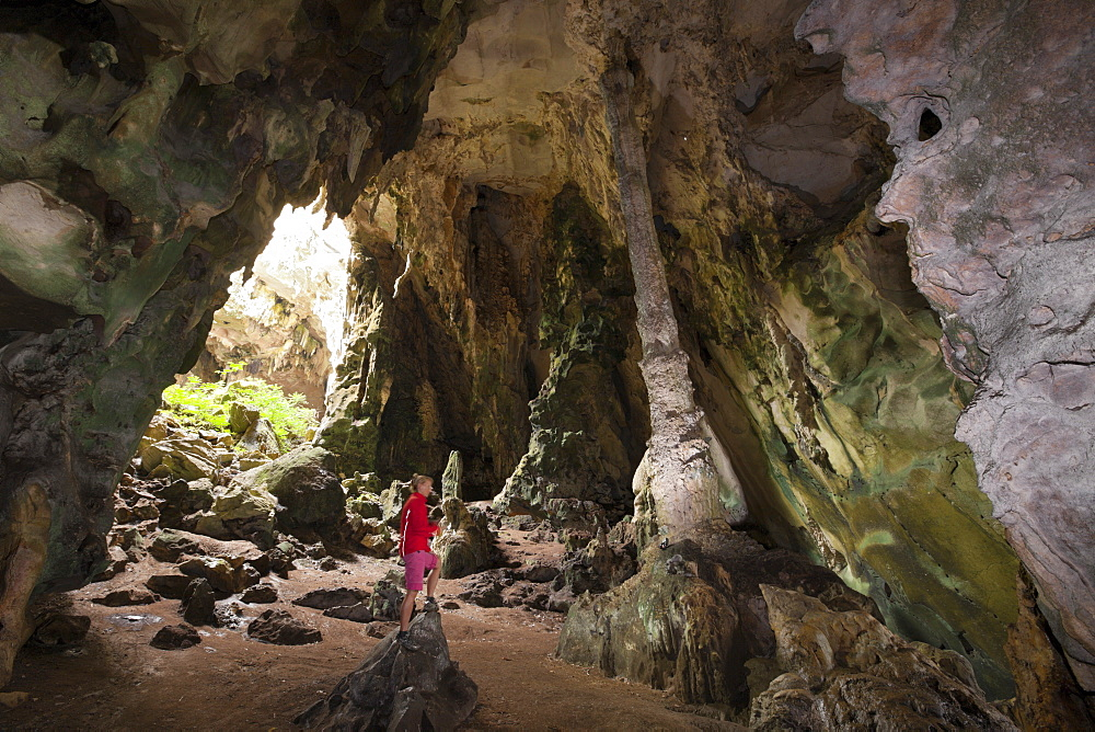 Tourist inside Kotilola Cave, Baliem Valley, West Papua, Indonesia, Southeast Asia, Asia - 759-9227